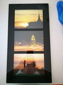 Wall mounted three aperture black glossy photo frame