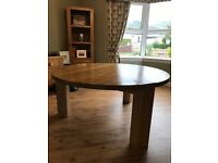Solid oak round dining table with 6 faux leather scroll chairs
