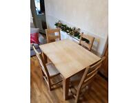Lovely solid oak dining table and 4 chairs