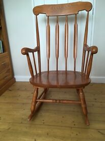 Wooden rocking chair, vgc and very comfortable! Light oak colour.