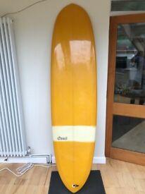 "7' 0"" mid length egg surfboard"
