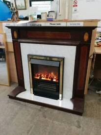 Electric fire with dark wood surround