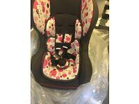 Pink reclining car seat