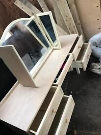 Dressing table with drawers and a mirror