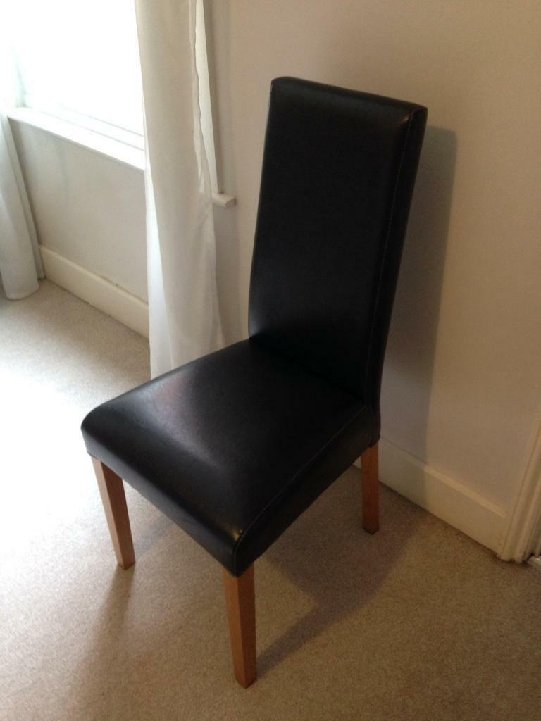 Dark brown faux leather chair.