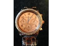 Rose gold colour watch