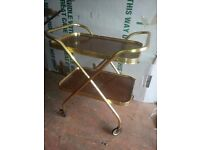 Brass/gold folding serving trolley, two tier.