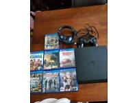 500gb Jet black PS4 with 7 games