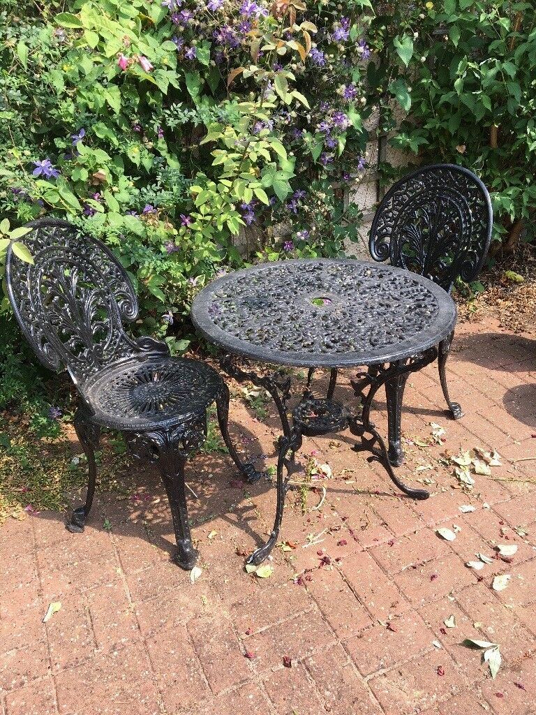 Cast iron garden furniture table and two chairs