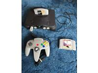 Nintendo 64 with controller and two games