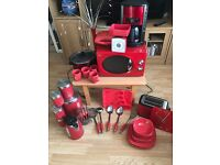 Red kitchen equipment inc cutlery, crockery, electrical items and storage