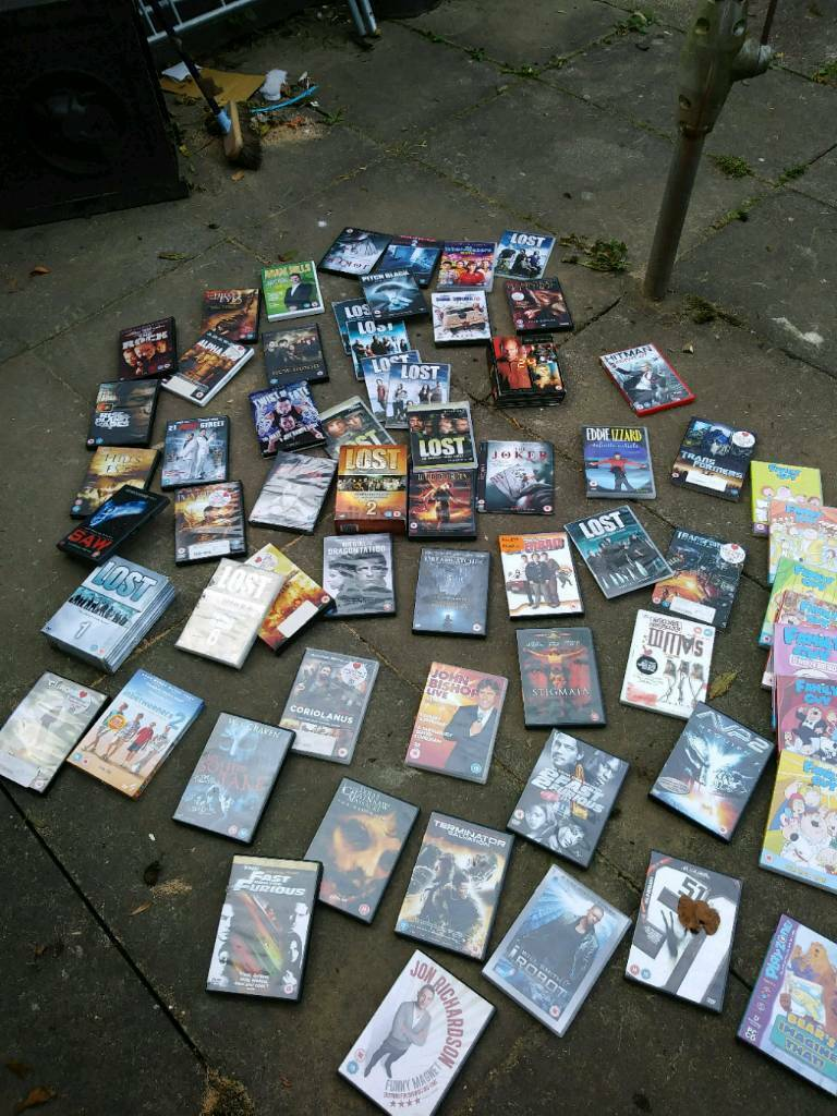 55 dvd s new and used.box sets.family guy.lost .all sorts