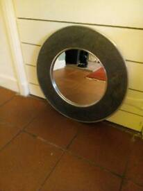 Slate and steel circular mirror from John Lewis