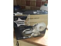 Tommee tippee electric breast pump only used twice , all cleaned and sterilized.