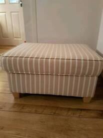 Beige striped storage footstool