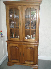 Display Cabinet and Cupboard - Medium Oak. Glass Fronted with internal lights.