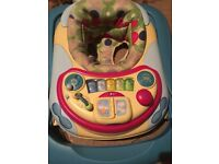 Baby walker with interactive play centre