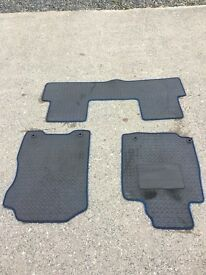 Honda CR-V full set of black leather mats trimmed in blue