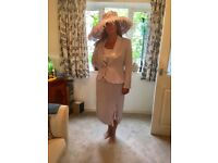 Elegant mother of the bride outfit and hat