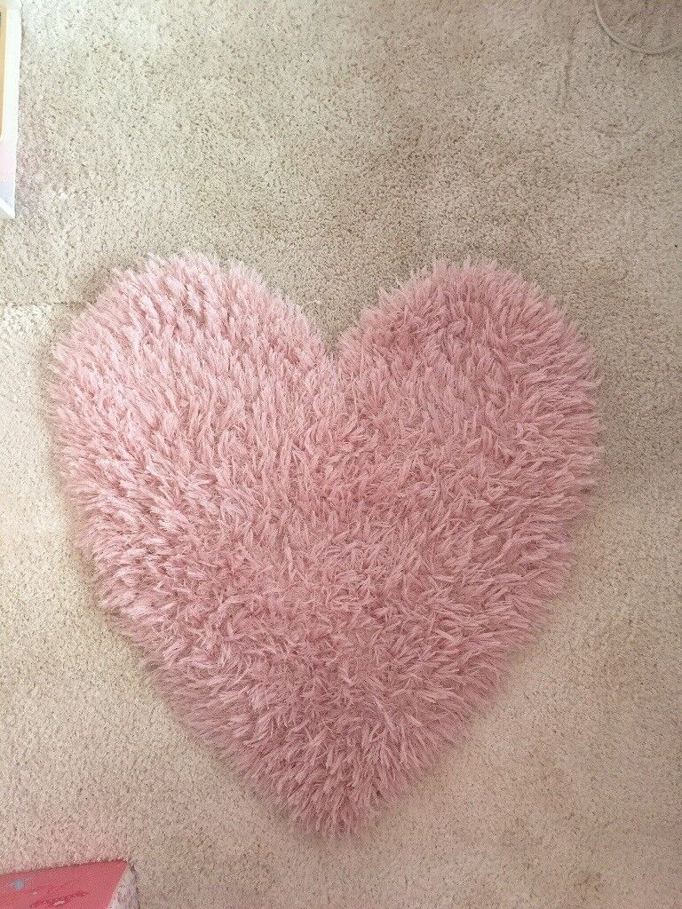 Pink heart shaped rug.