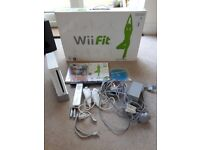 Wii console, controller, 2 numchucks, wii fit board and games