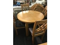 New oak extending table and four oak chairs