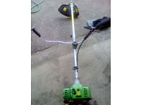 Heavy Duty Strimmer with Handles Harness and Various attachments.