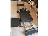 Aero Pilate 4cord exercise machine. Comes with trampoline board, level 1 DVD.