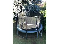 Supertramp 12 foot 'Fun Bouncer' trampoline with safety enclosure and ladder.