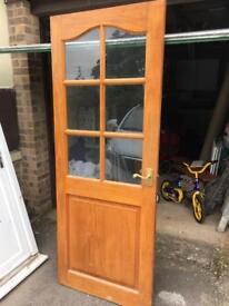 Traditional glazed door. 33x77in
