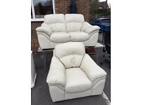 Cream leather settee and chair.