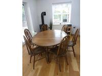 Oak drop leaf gate leg table and 6 oak wheelback dining chairs