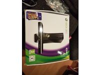Xbox 360 in the box with games and kinect