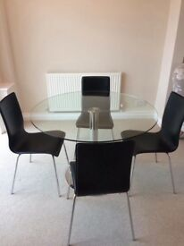 Dwell glass table and 4 black leather chairs
