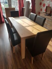 Dinning room table and faux black leather chairs