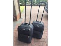 2 x trolley cabin suitcases. Good condition. Grey. All zips work. excellent buy only £10 for both!