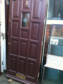 Exterior hardwood door with small glass panel