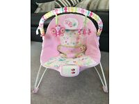 Pink baby bouncer with vibration & music