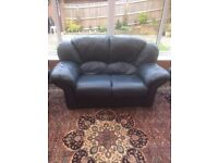 Two seater leather sofa and two armchairs