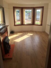 Lovely unfurnished 2 bed top floor flat right across from train station !
