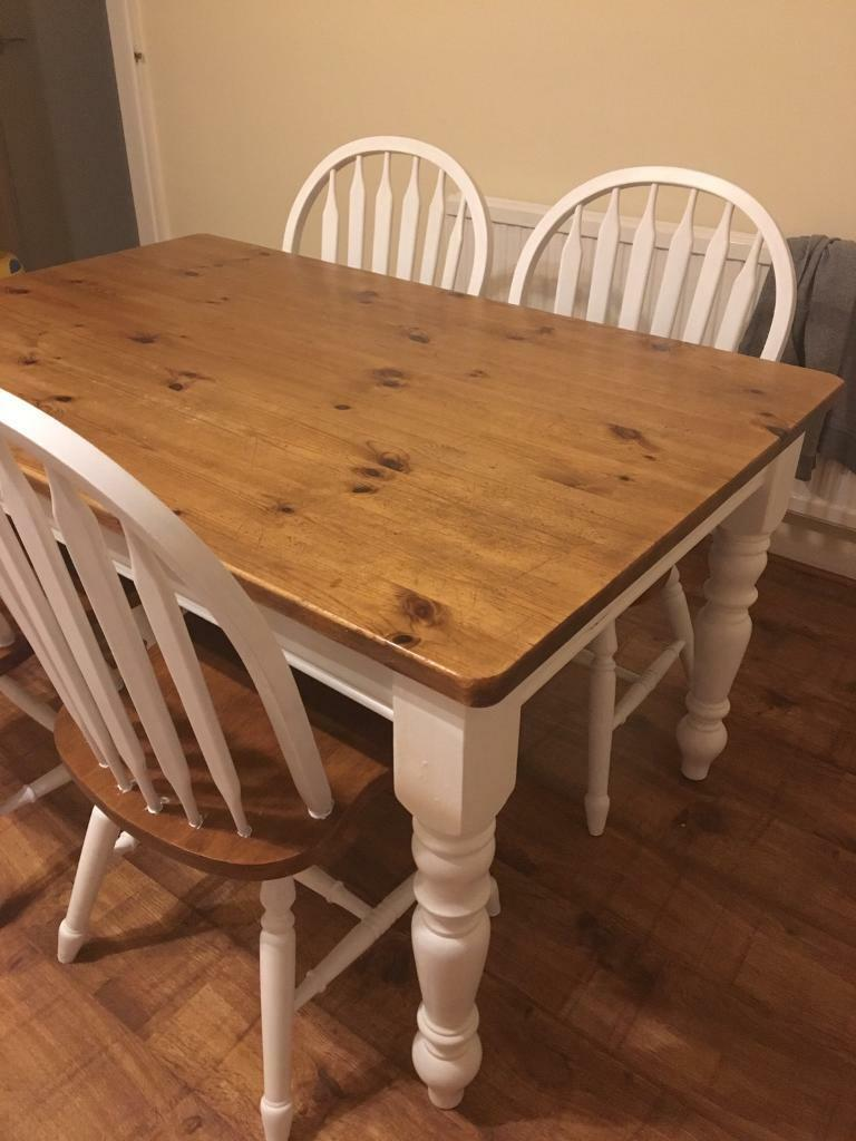 Farmhouse dining room table with four solid chairs