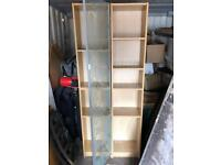 IKEA billy shelving units one with glass door