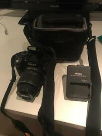 Nikon D3200 with 18-55mm lens, bag and charger