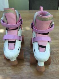 Adjustable pink roller skates