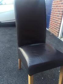 Six brown leather chairs