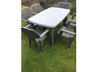 LARGE PATIO TABLE WITH SIX VERY STURDY MATCHING CHAIRS...