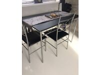 Black and silver table and 4 chairs