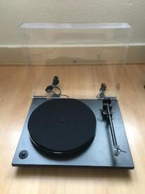 Rega RP1 turntable with performance pack and sumiko pearl cartridge.