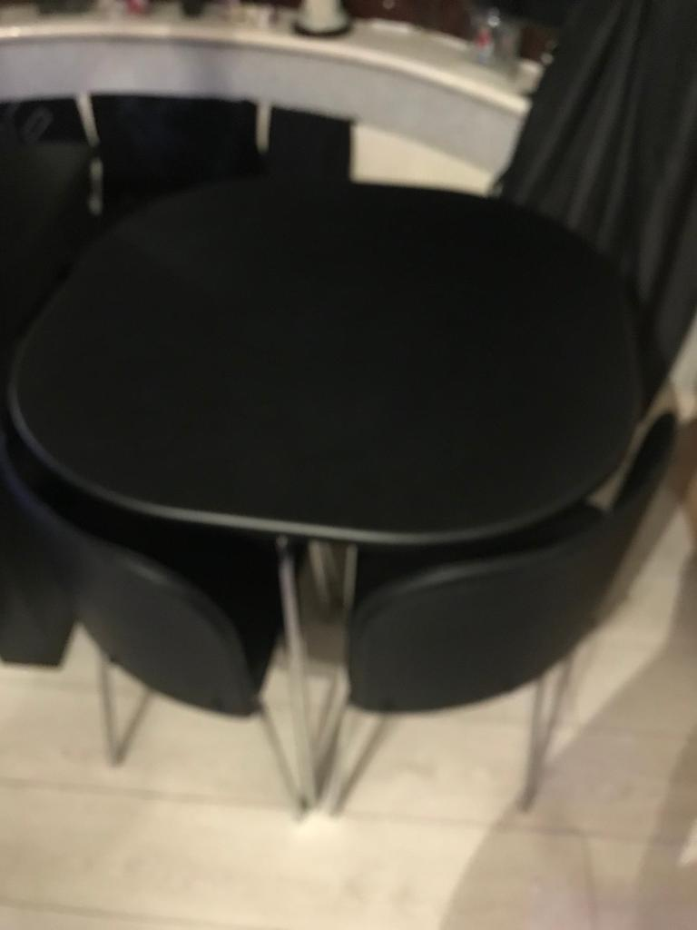 Space saver table and 4 chairs