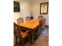 Solid wood dining room table with 6 chairs